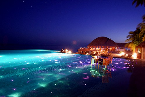 Infinity-Pool-with-dining-and-LED-lights-Huvafen-Fushi-Resort-in-Maldives
